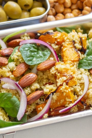 picture of Roasted Pumpkin and Almond Cous Cous Salad in a lunchbox