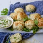 plate of rocket and parmesan scones with a dish of herbed cream cheese