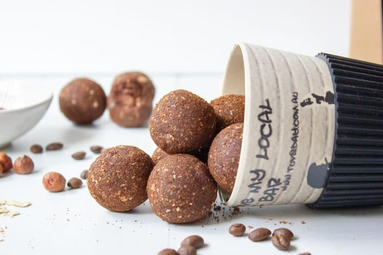 image of mocha bliss balls tumbling out of coffee cup