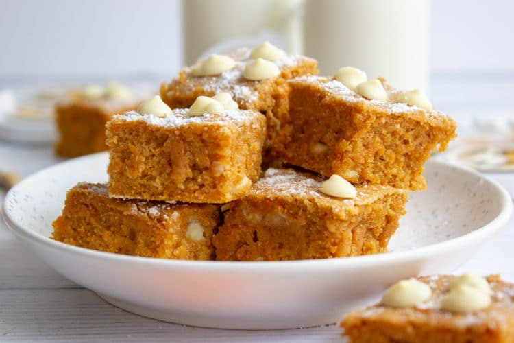 gingerbread blondies stacked on a plate